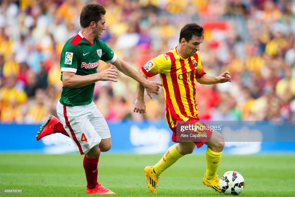 <a gi-track='captionPersonalityLinkClicked' href=/galleries/search?phrase=Lionel+Messi&family=editorial&specificpeople=453305 ng-click='$event.stopPropagation()'>Lionel Messi</a> (R) of FC Barcelona runs with the ball close to <a gi-track='captionPersonalityLinkClicked' href=/galleries/search?phrase=Aymeric+Laporte&family=editorial&specificpeople=7894319 ng-click='$event.stopPropagation()'>Aymeric Laporte</a> of Athletic Club during the La Liga match between FC Barcelona and Athletic Club at Camp Nou on September 13, 2014 in Barcelona, Spain.
