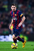 Lionel Messi of FC Barcelona runs with the ball during the La Liga match between FC Barcelona and Celta de Vigo at Camp Nou on November 1 2014 in...