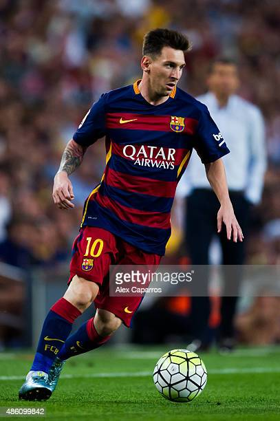Lionel Messi of FC Barcelona runs with the ball during the La Liga match between FC Barcelona and Malaga CF at Camp Nou on August 29 2015 in...