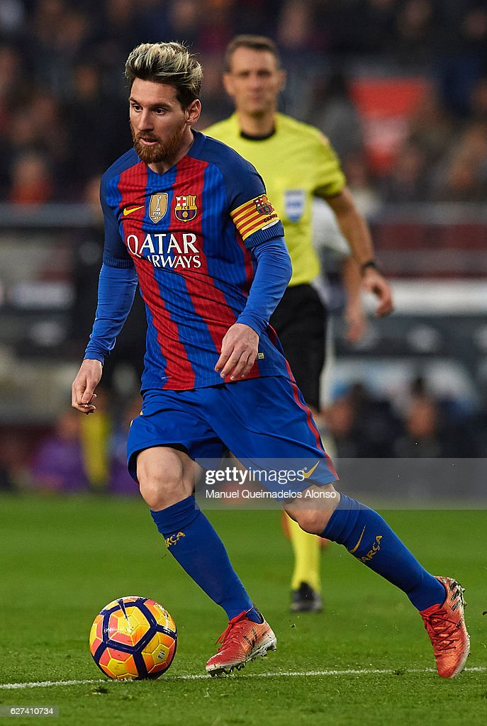 Lionel Messi of FC Barcelona runs with the ball during the La Liga match between FC Barcelona and Real Madrid CF at Camp Nou stadium on December 03...