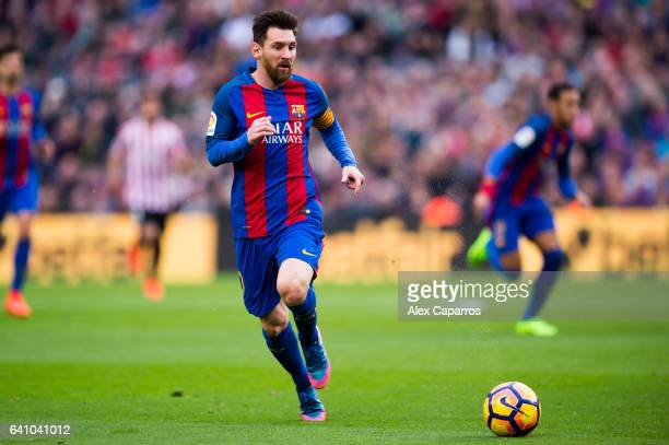 Lionel Messi of FC Barcelona runs with the ball during the La Liga match between FC Barcelona and Athletic Club at Camp Nou stadium on February 4...