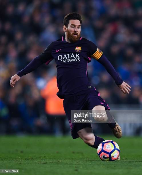 Lionel Messi of FC Barcelona runs with the ball during the La Liga match between RCD Espanyol and FC Barcelona at the RCDE Stadium on April 29 2017...