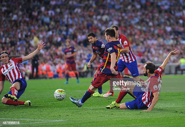 Lionel Messi of FC Barcelona scores his team's 2nd goal goal during the La Liga match between Club Atletico de Madrid and FC Barcelona at Vicente...