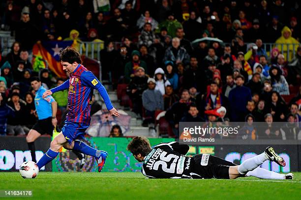 Lionel Messi of FC Barcelona scores his team's fifth goal during the La Liga match between FC Barcelona and Granada CF at Camp Nou on March 20 2012...