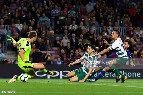 Lionel Messi of FC Barcelona scores his team's fifth goal during the La Liga match between Barcelona and SD Eibar at Camp Nou on September 19 2017 in...