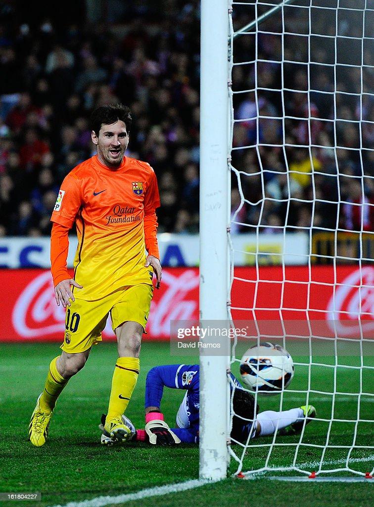 Lionel Messi of FC Barcelona scores his team's first goal during the La Liga match between Granada CF and FC Barcelona at Estadio Nuevo Los Carmenes on February 16, 2013 in Granada, Spain.
