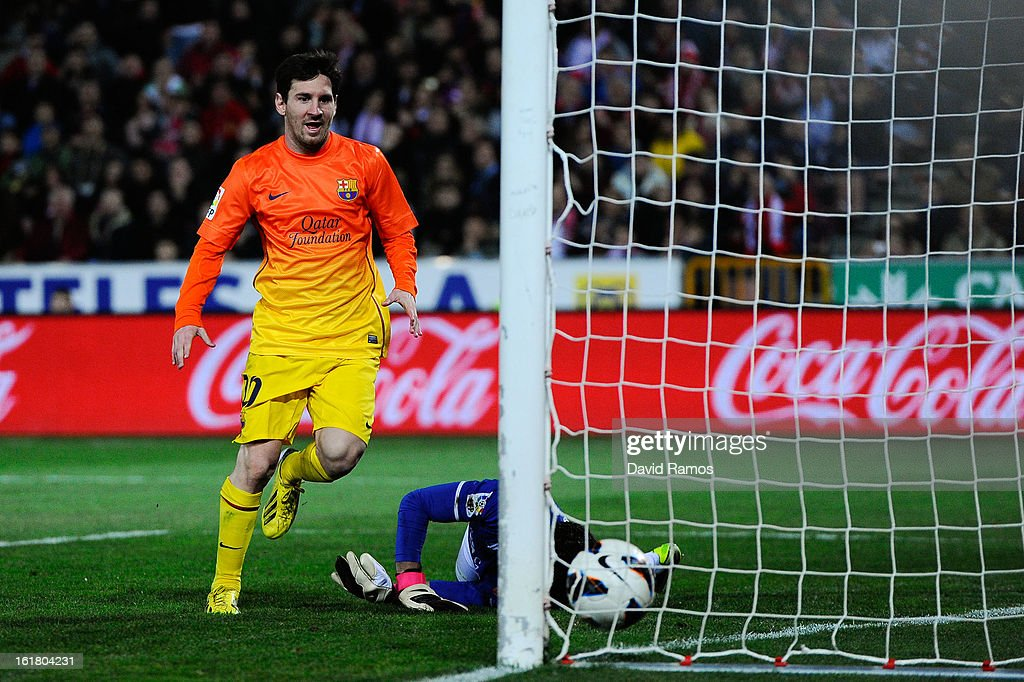 Lionel Messi of FC Barcelona scores his team's first goal during the La Liga match between Granada CF and FC Barcelona at Estadio Nuevo Los Carmenes on February 16, 2013 in Granada, Spain.