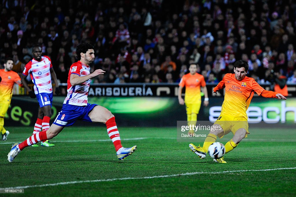 Lionel Messi of FC Barcelona scores his team's first goal during the La Liga match between Granada CF and FC Barcelona at Estadio Nuevo Los Carmenes on February 16, 2013 in Granada, Spain. This is the 300 goal with the FC Barcelona.