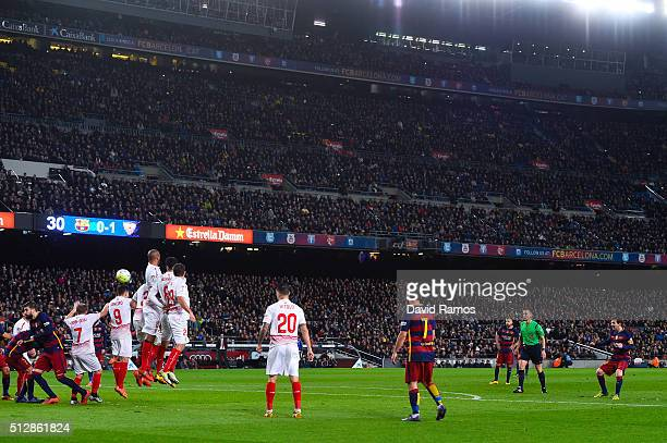 Lionel Messi of FC Barcelona scores his team's first goal during the La Liga match between FC Barcelona and Sevilla FC at Camp Nou on February 28...