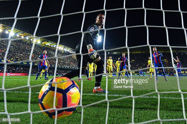 Lionel Messi of FC Barcelona scores his team's first goal during the La Liga match between Villarreal CF and FC Barcelona at Estadio de la Ceramica...