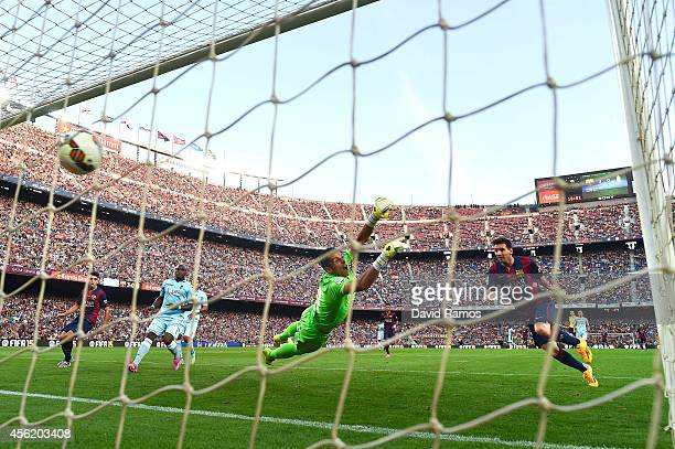 Lionel Messi of FC Barcelona scores his team's fourth goal during the La Liga match between FC Barcelona and Granada CF at Camp Nou on September 27...