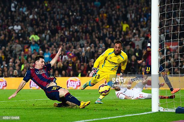 Lionel Messi of FC Barcelona scores his team's fourth goal during the La Liga match between FC Barcelona and Sevilla FC at Camp Nou on November 22...