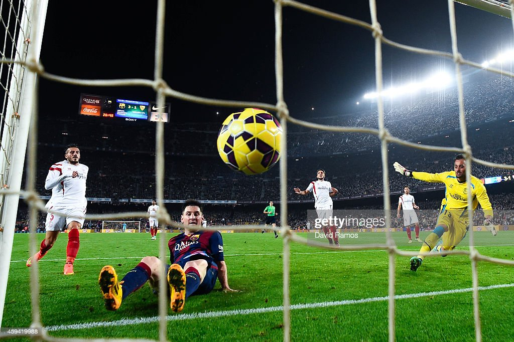 Lionel Messi of FC Barcelona scores his team's fourth goal ...