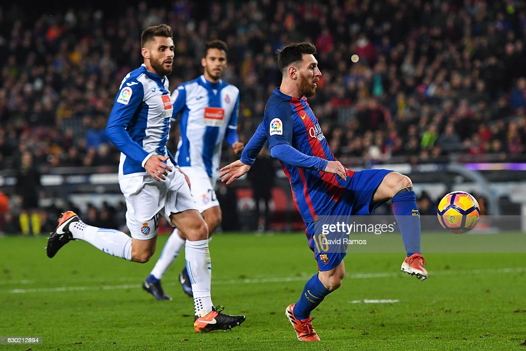 Lionel Messi of FC Barcelona scores his team's fourth goal during the La Liga match between FC Barcelona and RCD Espanyol at the Camp Nou stadium on December 18, 2016 in Barcelona, Spain.