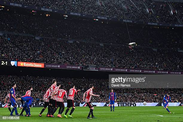 Lionel Messi of FC Barcelona scores his team's third goal during the Copa del Rey round of 16 second leg match between FC Barcelona and Athletic Club...