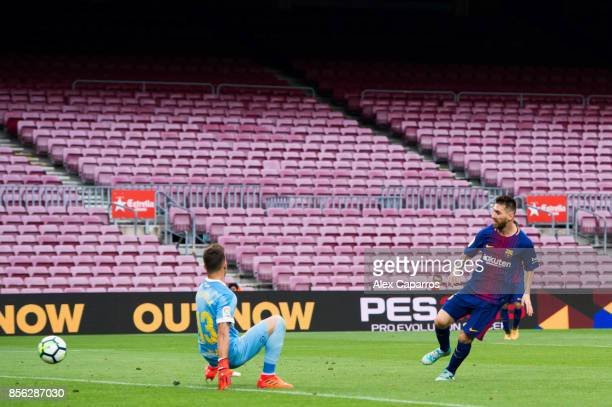 Lionel Messi of FC Barcelona scores his team's third goal during the La Liga match between Barcelona and Las Palmas at Camp Nou on October 1 2017 in...