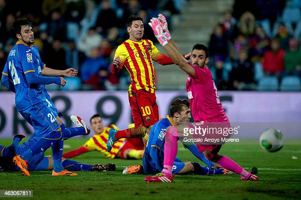 Lionel Messi of FC Barcelona scores the opening goal during the Copa del Rey Round of 8 second leg match between Getafe CF and FC Barcelona at...