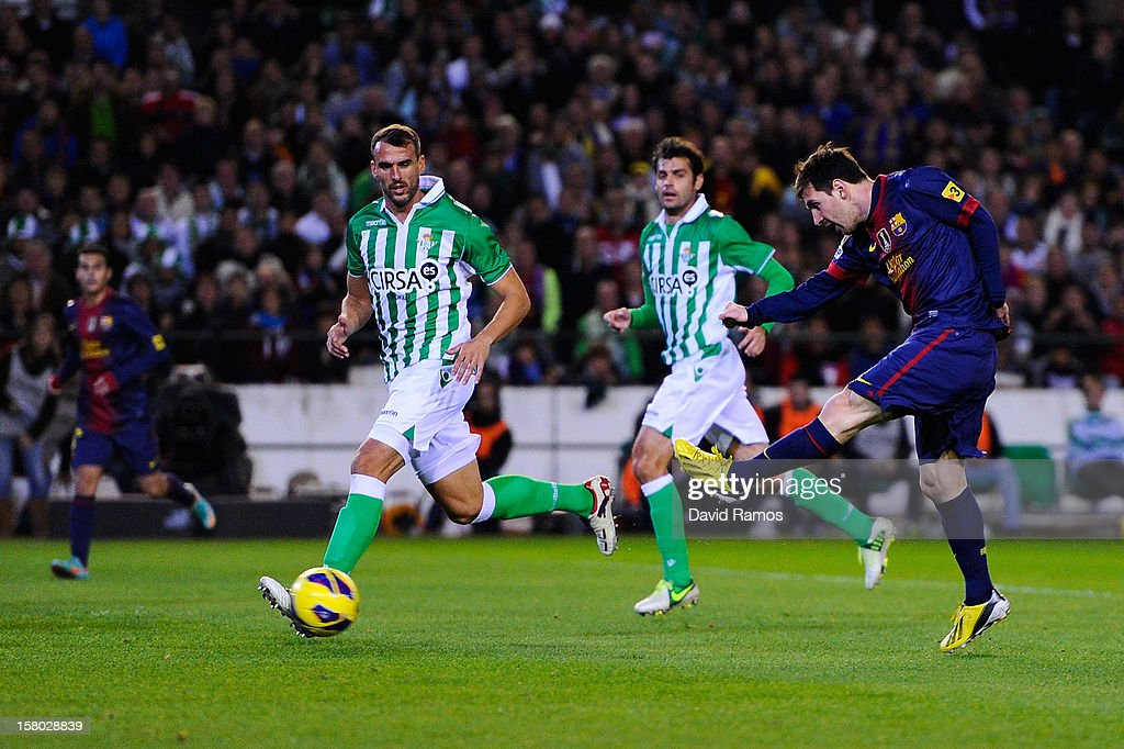 Lionel Messi of FC Barcelona scores the opening goal during the La Liga match between Real Betis Balompie and FC Barcelona at Estadio Benito...