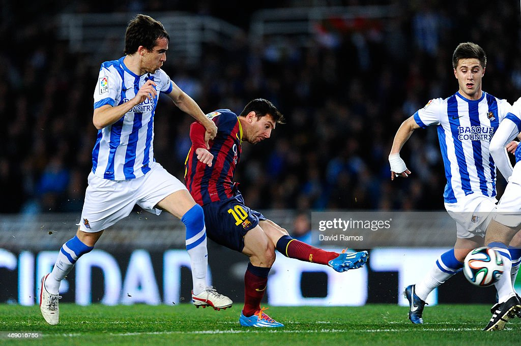 Lionel Messi of FC Barcelona scores the opening goal next to Mikel Gonzalez Martinez of Real Sociedad during the Copa del Rey Semi Final second leg...