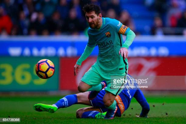Lionel Messi of FC Barcelona scores their fourth goal during the La Liga match between Deportivo Alaves and FC Barcelona at Estadio de Mendizorroza...
