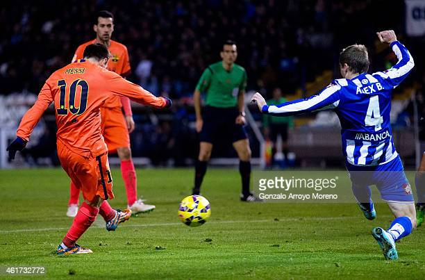 Lionel Messi of FC Barcelona scores their third goal during the La Liga match between RC Deportivo La Coruna and FC Barcelona at Riazor Stadium on...