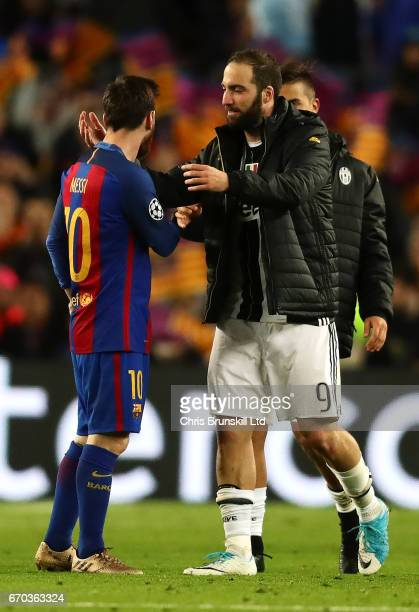 Lionel Messi of FC Barcelona shakes hands with Gonzalo Higuain of Juventus at the end of the UEFA Champions League Quarter Final second leg match...