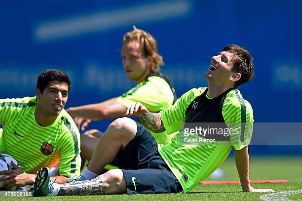 Lionel Messi of FC Barcelona shares a joke with Luis Suarez of FC Barcelona during a FC Barcelona open Media Day ahead of their UEFA Champions League...