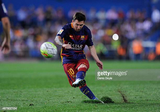 Lionel Messi of FC Barcelona shoots a free kick during the La Liga match between Club Atletico de Madrid and FC Barcelona at Vicente Calderon Stadium...