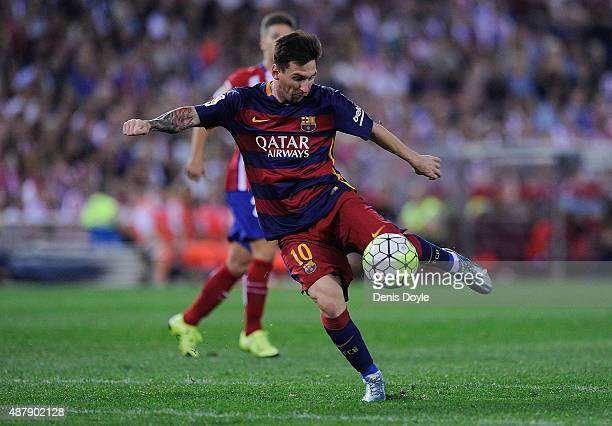 Lionel Messi of FC Barcelona shoots at goal during the La Liga match between Club Atletico de Madrid and FC Barcelona at Vicente Calderon Stadium on...
