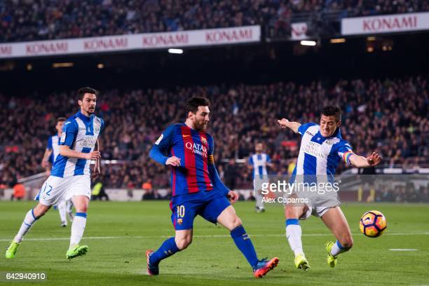 Lionel Messi of FC Barcelona shoots on goal between Martin Maximiliano Mantovani and Erik Moran of CD Leganes during the La Liga match between FC...