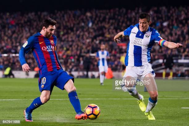 Lionel Messi of FC Barcelona shoots on goal next to Martin Maximiliano Mantovani of CD Leganes during the La Liga match between FC Barcelona and CD...