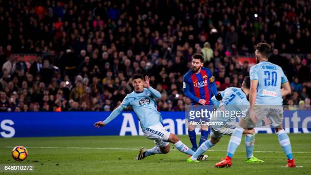Lionel Messi of FC Barcelona shoots the ball and scores his team's fifth goal during the La Liga match between FC Barcelona and RC Celta de Vigo at...