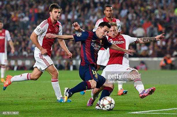 Lionel Messi of FC Barcelona shoots towards goal during a UEFA Champions League Group F match between FC Barcelona and AFC Ajax at the Camp Nou...