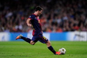 Lionel Messi of FC Barcelona shoots towards goal during the UEFA Champions League Group G match between FC Barcelona and Celtic FC at the Camp Nou...
