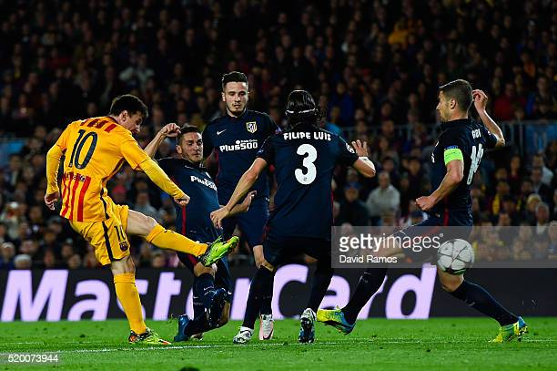 Lionel Messi of FC Barcelona shoots towards goal under pressure of Club Atletico de Madrid players during the UEFA Champions League quarter final...