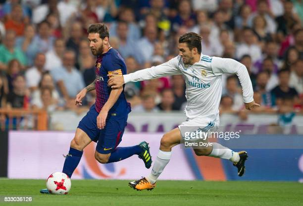 Lionel Messi of FC Barcelona slips past Mateo Kovacic of Real Madrid CF during the Supercopa de Espana Final 2nd Leg match between Real Madrid and FC...