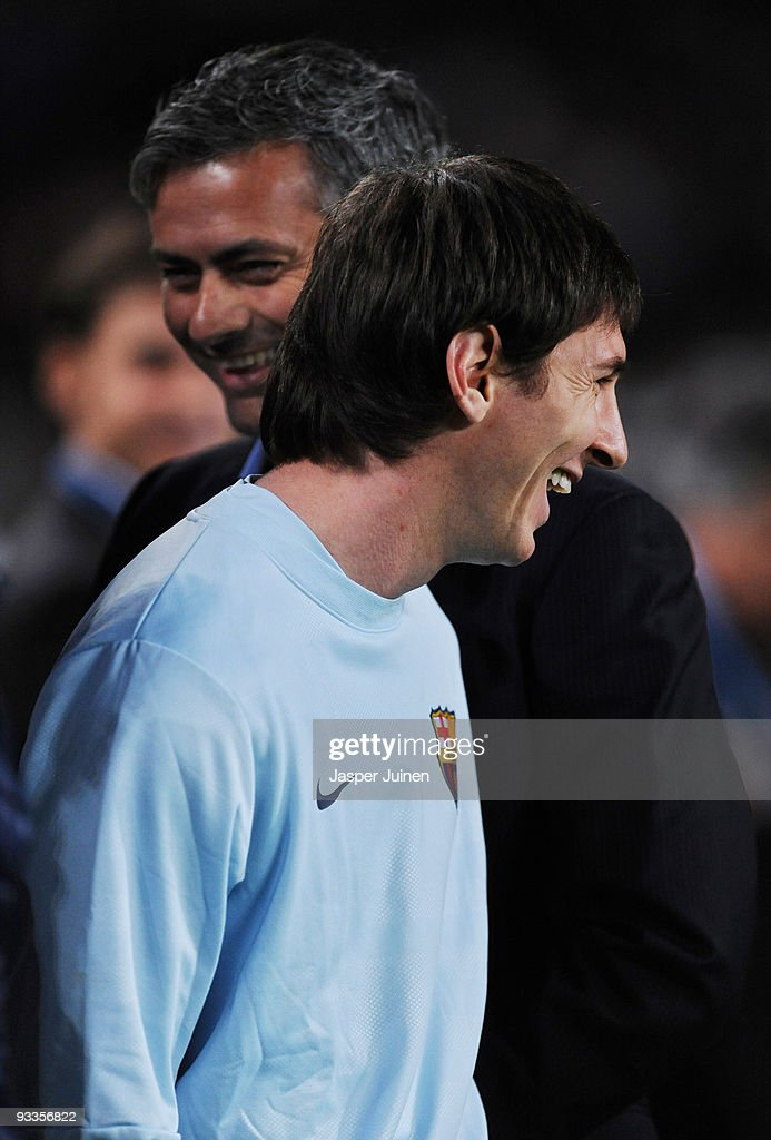 <a gi-track='captionPersonalityLinkClicked' href=/galleries/search?phrase=Lionel+Messi&family=editorial&specificpeople=453305 ng-click='$event.stopPropagation()'>Lionel Messi</a> (R) of FC Barcelona smiles backdropped by Inter Milan coach Jose Mourinho as prepares to watch from the sidelines due to an injury prior to the start of the UEFA Champions League group F match between FC Barcelona and Inter Milan at the Camp Nou Stadium on November 24, 2009 in Barcelona, Spain.