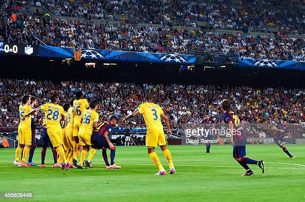 Lionel Messi of FC Barcelona takes a free kick during the UEFA Champions League Group F match between FC Barcelona and APOEL FC at the Camp Nou...