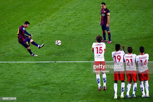 Lionel Messi of FC Barcelona takes a freekick during the La Liga match between FC Barcelona and UD Almeria at Camp Nou on April 8 2015 in Barcelona...