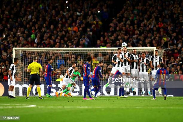 Lionel Messi of FC Barcelona takes a freekick during the UEFA Champions League Quarter Final second leg match between FC Barcelona and Juventus at...