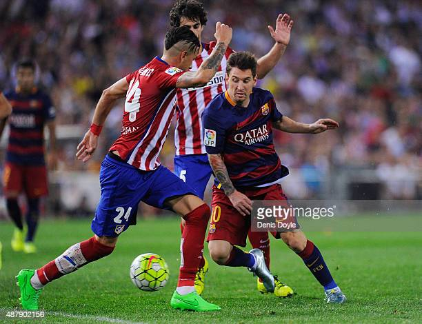 Lionel Messi of FC Barcelona takes on Jose Maria Gimenez of Club Atletico de Madrid during the La Liga match between Club Atletico de Madrid and FC...