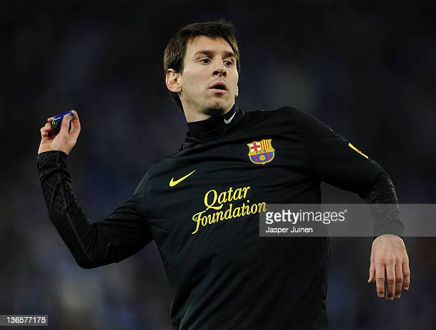 Lionel Messi of FC Barcelona throws back a lighter towards the Espanyol supperters during the la Liga match between RCD Espanyol and FC Barcelona at...