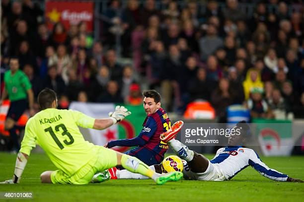 Lionel Messi of FC Barcelona tries to score between Kiko Casilla and Eric Bailly of RCD Espanyol during the La Liga match between FC Barcelona and...