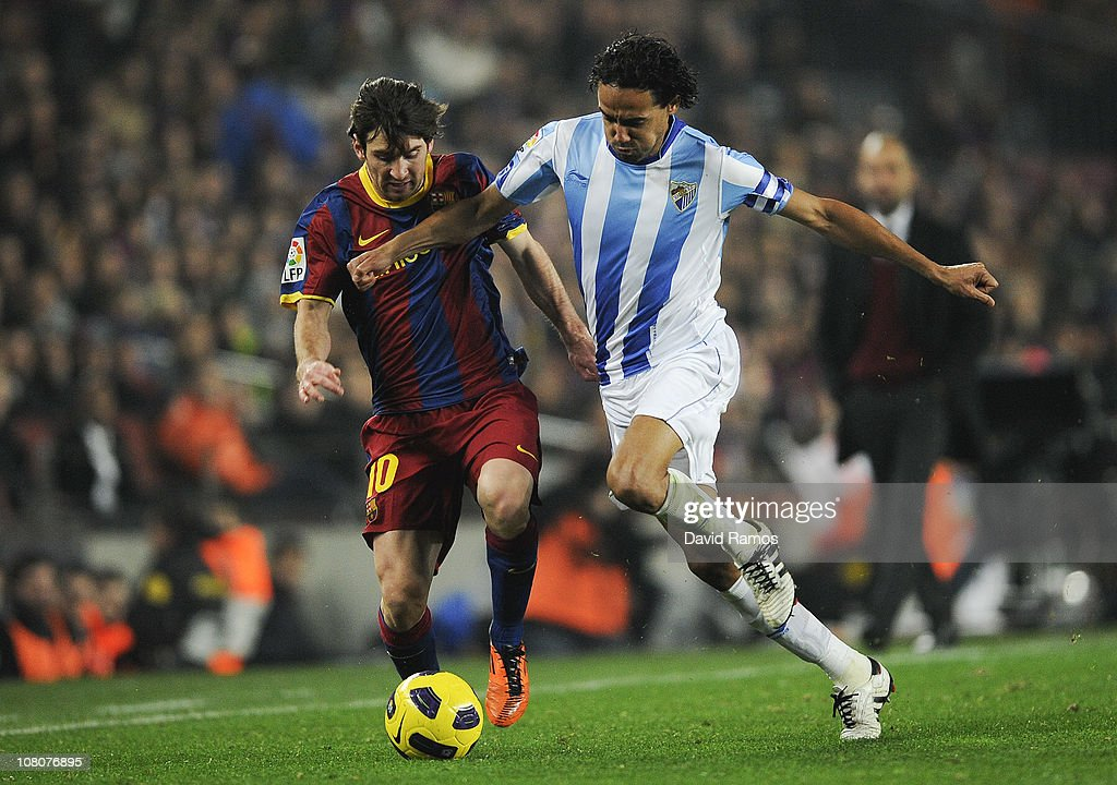 <a gi-track='captionPersonalityLinkClicked' href=/galleries/search?phrase=Lionel+Messi&family=editorial&specificpeople=453305 ng-click='$event.stopPropagation()'>Lionel Messi</a> of FC Barcelona (L) vies for the ball with Weligton of Malaga (L) during the La Liga match between FC Barcelona and Malaga at Nou Camp on January 16, 2011 in Barcelona, Spain. Barcelona won 4-1.