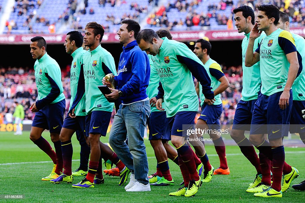 <a gi-track='captionPersonalityLinkClicked' href=/galleries/search?phrase=Lionel+Messi&family=editorial&specificpeople=453305 ng-click='$event.stopPropagation()'>Lionel Messi</a> of FC Barcelona walks out with his team mates holding the Golden Boot he was awarded after scoring 46 goals last season during the La Liga match between FC Barcelona and Granda CF at Camp Nou on November 23, 2013 in Barcelona, Spain.