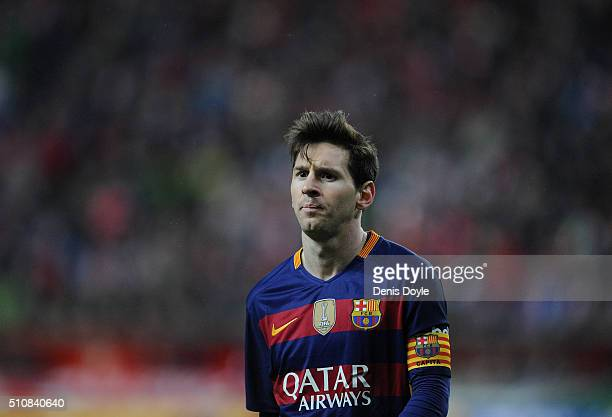 Lionel Messi of FC Barcelona walks over to take a corner kick during the La Liga match between Sporting Gijon and FC Barcelona at Estadio El Molinon...
