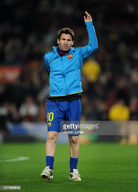 """Lionel Messi of FC Barcelona warms up waering his personalized """"Golden Football Boots"""" prior to the start of the la Liga match between FC Barcelona..."""