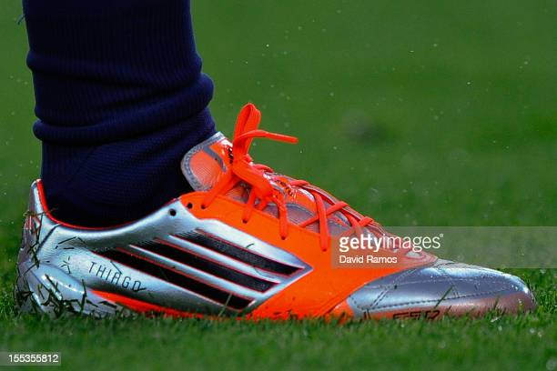 Lionel Messi of FC Barcelona warms up wearing his personalised new boots with the name of his newborn son Thiago prior to the star of the La Liga...