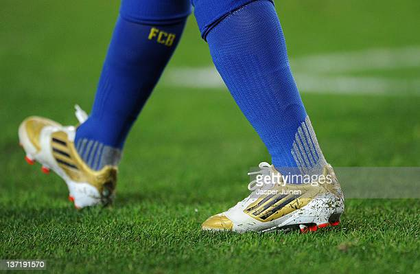 """Lionel Messi of FC Barcelona warms up wearing his personalized """"Golden Football Boots"""" prior to the start of the la Liga match between FC Barcelona..."""