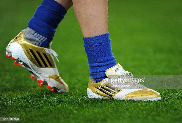 "Lionel Messi of FC Barcelona warms up wearing his personalized ""Golden Football Boots"" prior to the start of the la Liga match between FC Barcelona..."